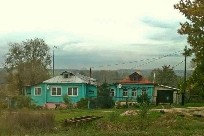 Traditional Russian wooden house along the road