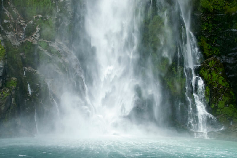 Thundering waterfall at Milford Sound