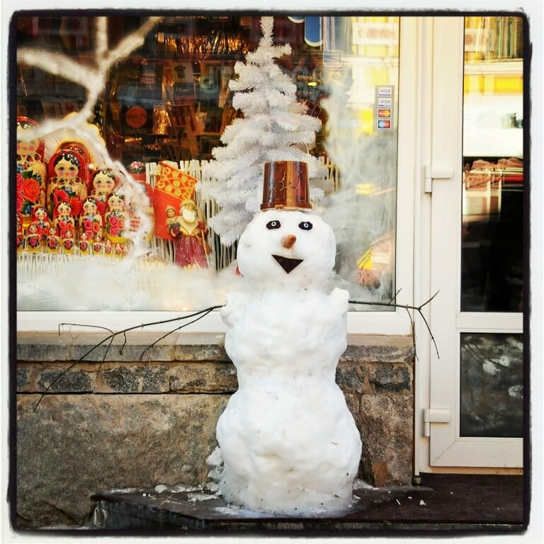 Snowman at the front of a shop on the  Old Arbat street