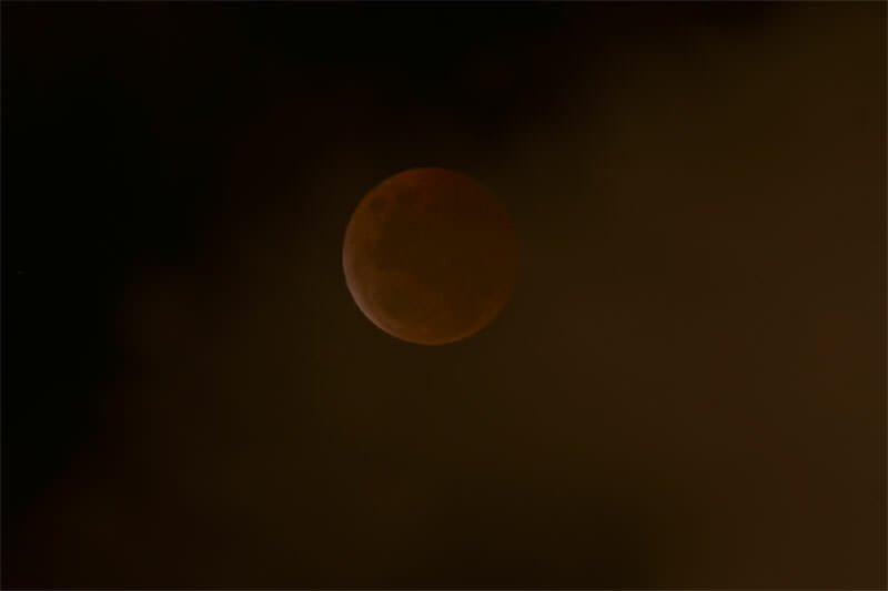 Blood moon hidden by clouds