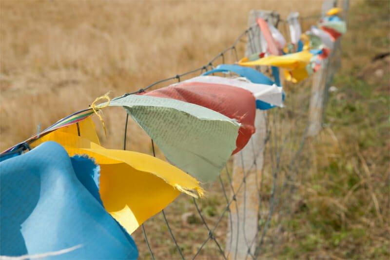 Visit Tibetan Plateau - prayer flags on Ruoergai Grassland