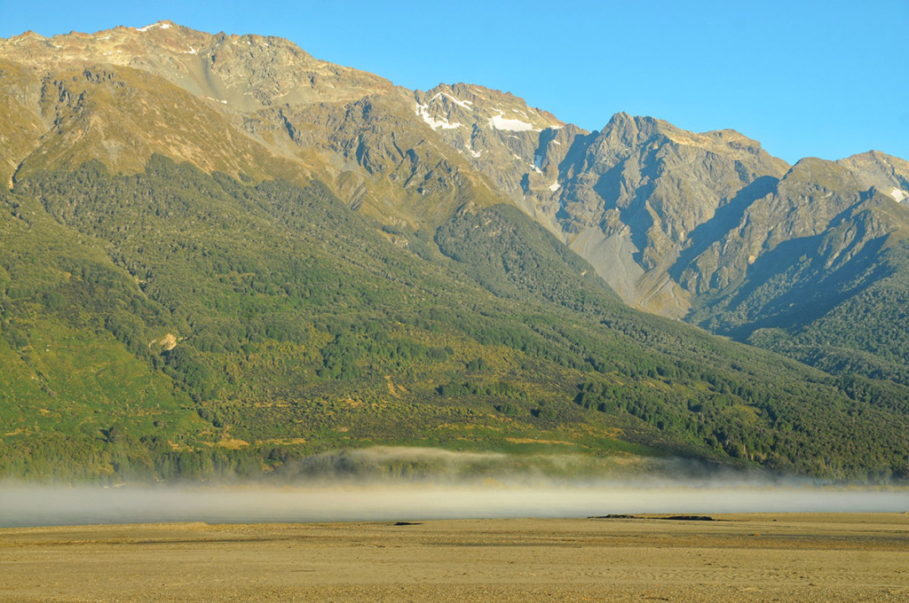 fog lifting off Lake Wakatipu in Glenorchy