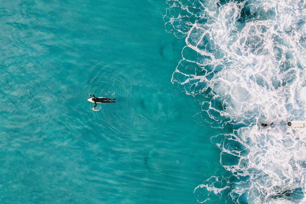 Surfing in the crystal clear water